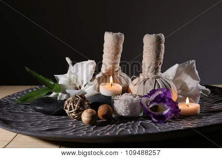 Beautiful spa composition in a bowl on dark background