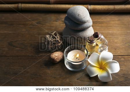 Decorated relax treatments with frangipani flower on wooden background