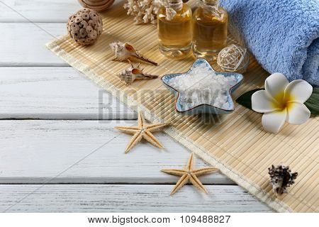 Beautiful spa treatments on decorated wooden background