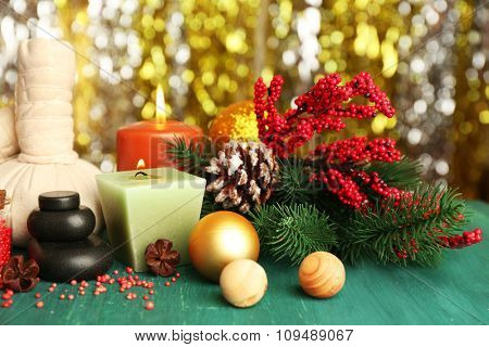 Beautiful Christmas presents composition on green wooden table against sparkle background, close up