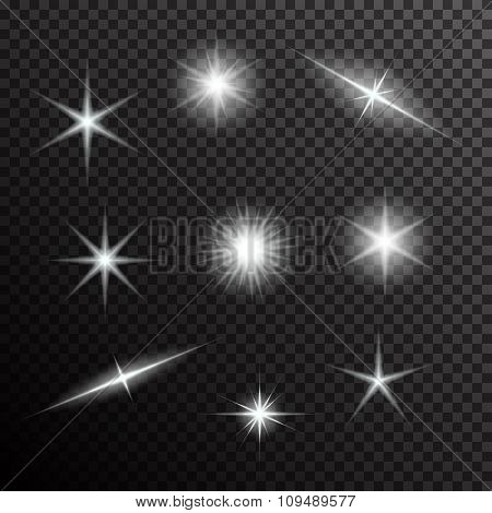 Vector set of glowing light bursts on black