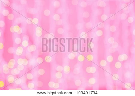 holidays, party and celebration concept - blurred pink and golden background with bokeh lights