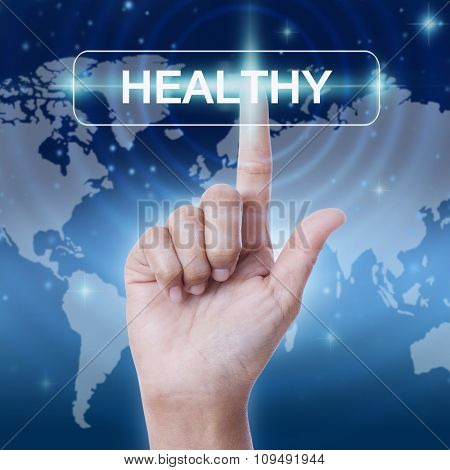 hand pressing healthy word button on virtual screen. business concept