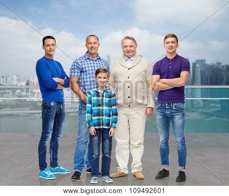 travel, tourism, generation and people concept - group of smiling men and boy over singapore city background