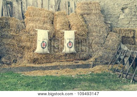 archery target on the background of haystacks at countryside