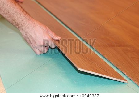 worker installing new laminate flooring