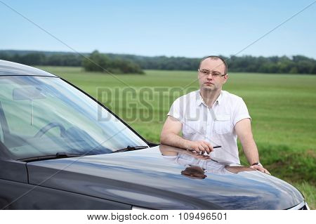 Man  Near The Car Onthe Road