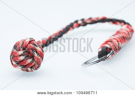 braided laces keychain. bludgeon for self-defense. white background