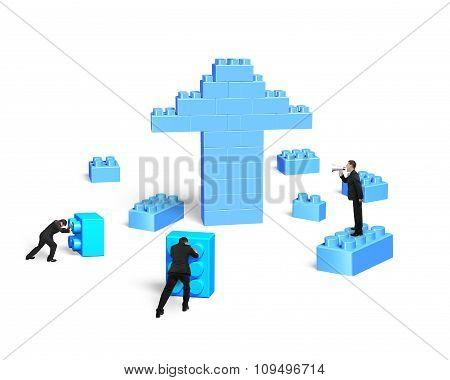 Businessmen Building Stack Blocks In Arrow Up Shape