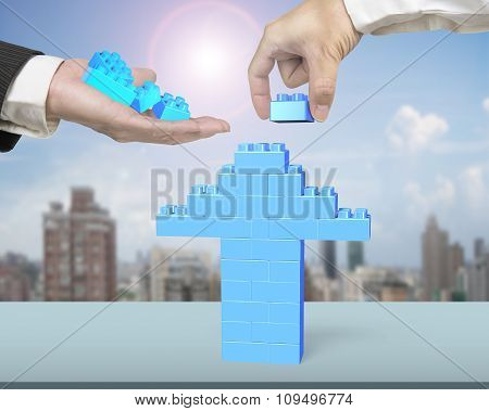 One Hand Holding Stack Blocks The Other Completing Arrow Up
