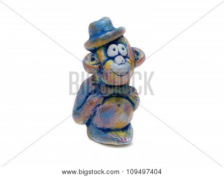 merry monkey in blue bowler hat from clay pottery. isolated on white