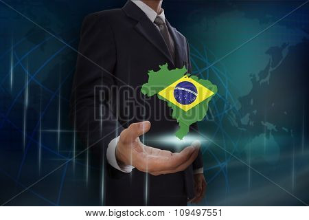 Businessman showing map of Brazil on globe background