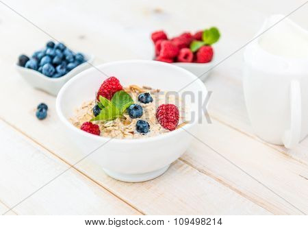 delicious breakfast with muesli and berries