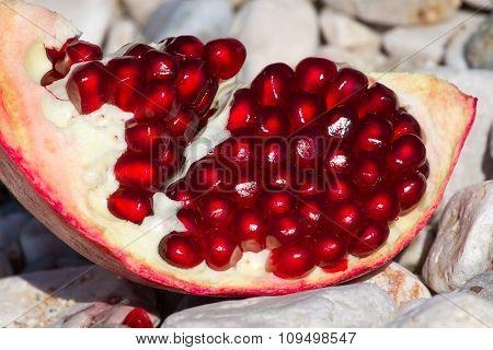 Part of pomegranate fruit. Organic fresh juicy product
