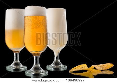 Glasses Of Beer And Nachos