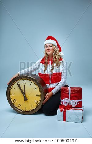 Girl dressed in santa hat with a Christmas decorations