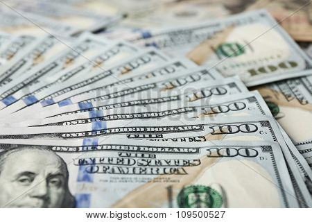 Fan shaped hundred dollars cash money as background