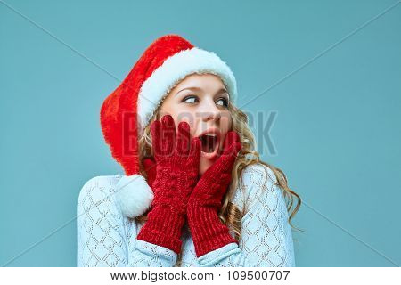 portrait of girl dressed in santa hat