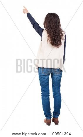Back view of  pointing. Rear view people collection.  backside view of person.  Isolated over white background. A girl in a white tank top showing his hand up.