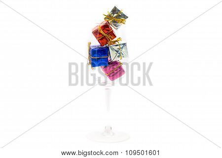 Small Gift Boxes In Glass Isolated On White Background