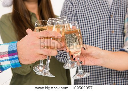 Young People Celebrating Event With Champagne