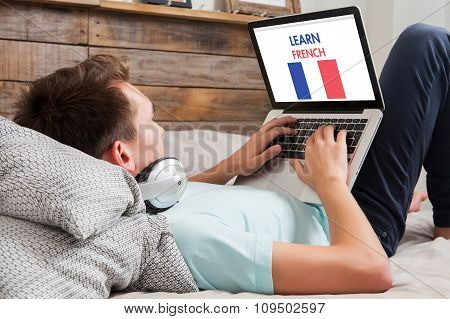 Man Learning French At Home.