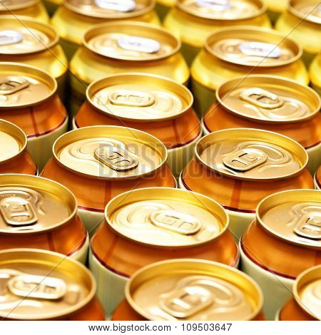 A lot of gold beer cans. Shallow DOF