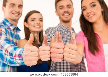Closeup Photo Of A Happy Cheerful  Group Showing Thumbs Up