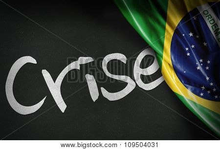 Crisis (Crise in Portuguese) on blackboard and the Brazilian flag