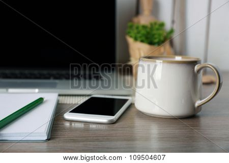 Decorated workplace with laptop in the modern room