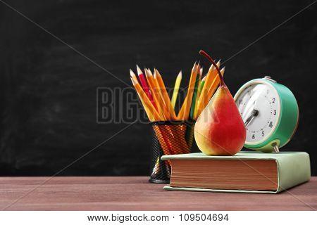 School equipment on blackboard background