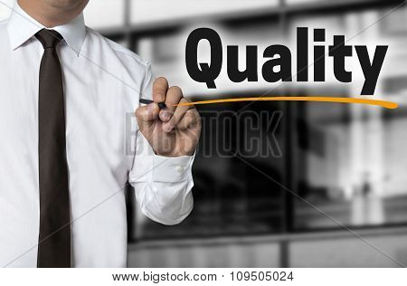 Quality Is Written By Businessman Background Concept