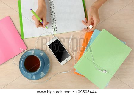 Woman doing paperwork on the desk