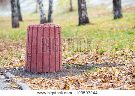 Red Cement Trash Bin In The Park
