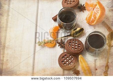 Chocolate Dessert In A Glass On A White Table With Cinnamon Cookies And Citrus