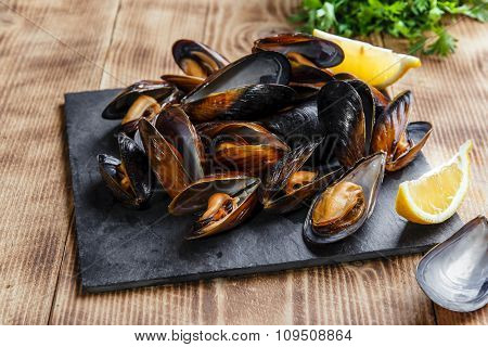 mussels steamed oysters with lemon and herbs