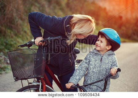 Mother Teaching Son Cycling