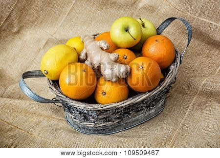 Tin Wicker Basket With Apples, Oranges, Lemons And Ginger