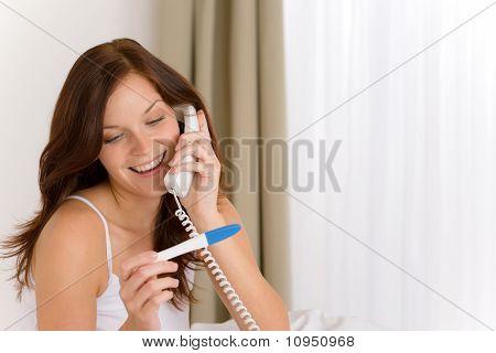 Pregnancy Test - Happy Woman On Phone