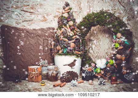 New year decorations. Christmas tree, cinnamon, cushion, wreath, snow.  toning photo.