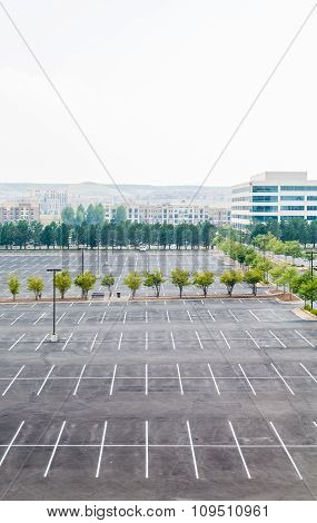 Empty Parking Lot With One Car