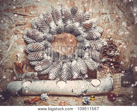 New year decorations. Christmas tree, cinnamon, wooden candlestick, wreath of cones, snow.  toning p