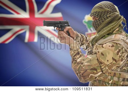 Male In Muslim Keffiyeh With Gun In Hand And National Flag On Background - Cayman Islands