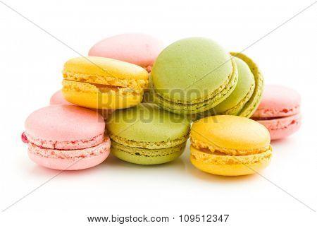 colorful macarons on white background