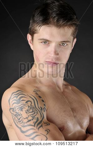 Portrait Of Attractive Men With Tattoo  Of Tiger On Shoulder.