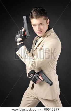 Handsome Man With A Gun Wearing A White Suit