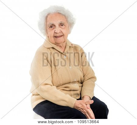 portrait of smiling elderly woman with grey hair