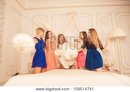 Cute Girls Celebrating A Bride's Bachelorette Party And Playing With Pillows