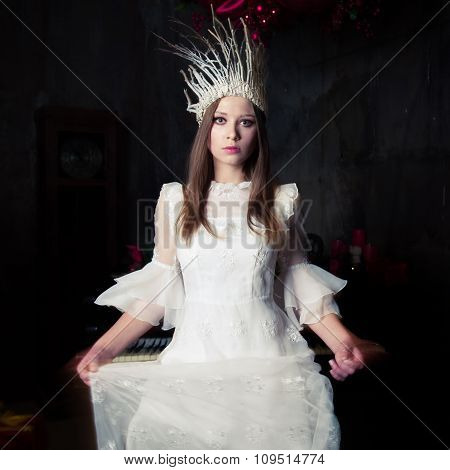 Woman In White Crown And White Dress