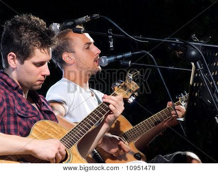 Two Guitar Players